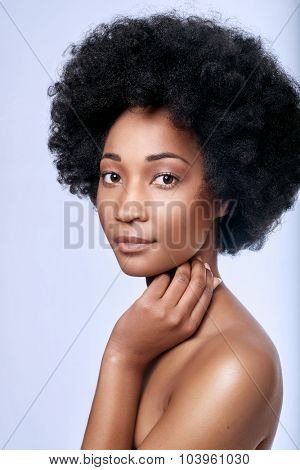 Headshot of pretty young black african model in studio with smooth complexion flawless skin, skincare beauty concept