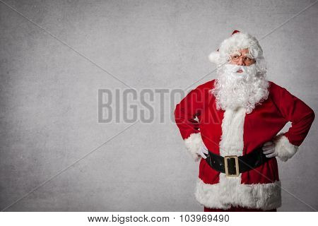 Santa Claus standing surprised in front of a wall