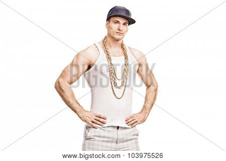 Studio shot of a young male rapper with a blue cap and a golden chain looking at the camera isolated on white background