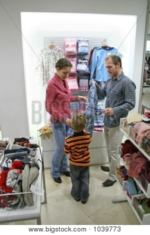 Parents With Child In Shop