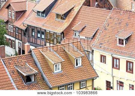 Roofs of half-timbered houses in Quedlinburg town, Germany poster