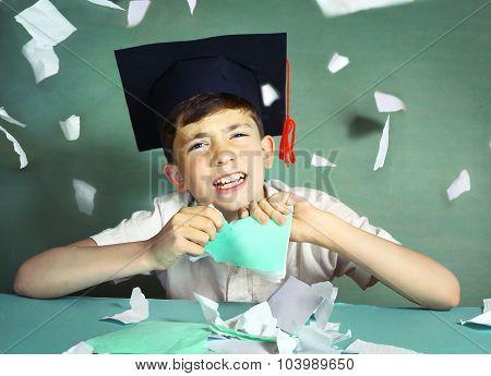 Boy In Graduation Cap  Tear His Copycook