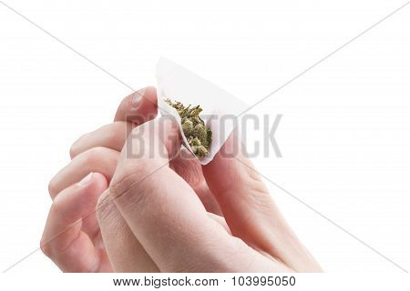 Preparing A Cannabis Joint.