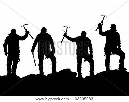 Black Silhouette Of Four Climbers With Ice Axe In Hand