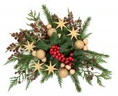 Christmas flora with gold bauble and star decorations with holly, ivy and winter greenery over white background. poster