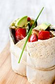 Healthy vegetarian vegan tortilla wraps with roasted vegetables like aubergine eggplant, red bell peppers, avocado  poster