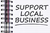 support local business words on spring note book. poster