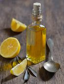Liver Detox with olive oil and lemon fruits on the wooden table poster
