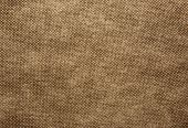 A sheet of thick coarsely woven fabric in brown colour.Texture and background.Horizontal view. poster