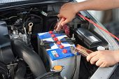 Charging battery car with electricity trough jumper cables poster