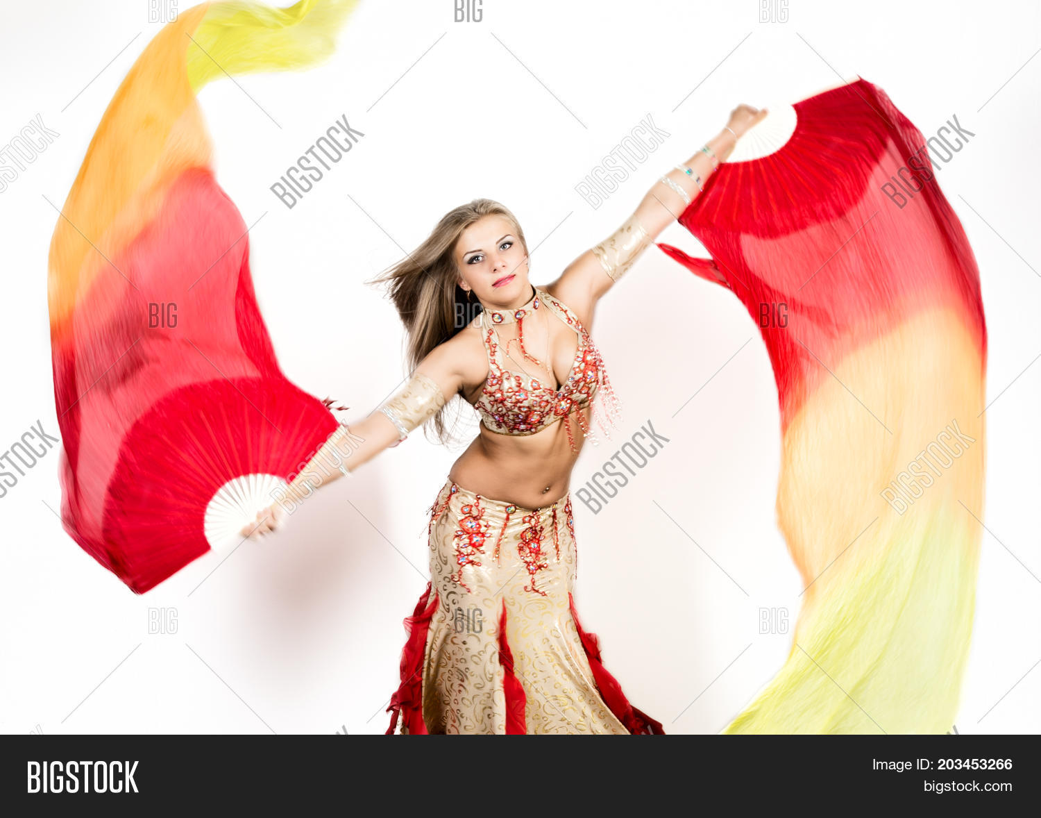 8e4895572741a Arabic dance with fans and ribbons performed by a beautiful plump woman.