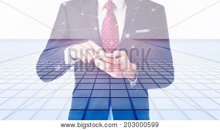 Business concept for information communication connection technology - double exposure effect of office man and panoramic modern city skyline bird eye aerial night view under dramatic dark blue sky