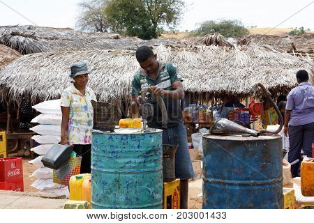 Man Sell Petrol On Rural Madagascar Marketplace