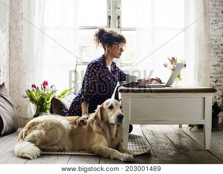 Woman Petting Golden Retriever Dog