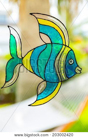 Window painting of fish made by window colors