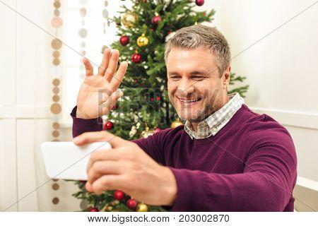 Man Taking Selfie With Smartphone