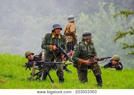 Soldiers with machine guns.The VIII International Festival of Military History and remake for the battle `1944` 6.08.2016 in Valga, Estonia