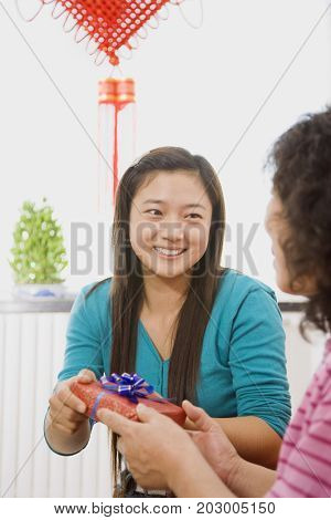 Chinese woman giving mother gift