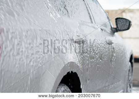 The car is located at a car wash in a special center