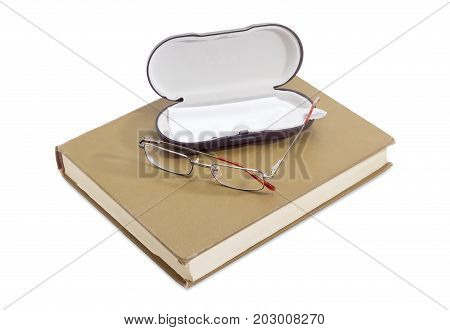 Modern classic men's eyeglasses and case on the book