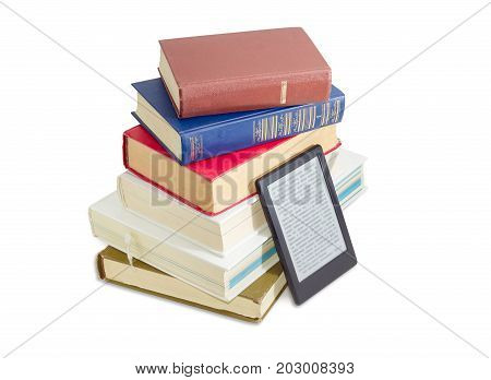 Ebook reader near of a stack of ordinary paper books on a white background