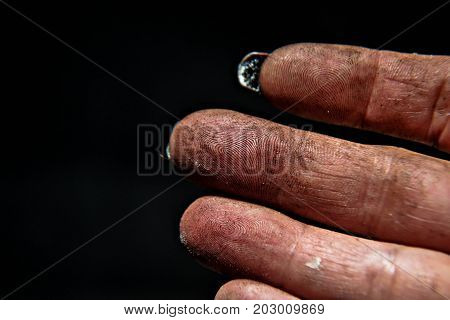 Fingers and fingertips on the black background