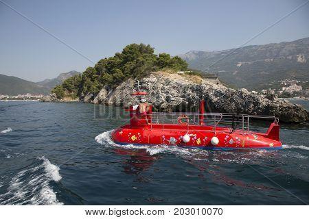 BUDVA, MONTENEGRO - AUGUST 07, 2017:Pleasure boat in the form of a submarine off the coast of Budva Montenegro.