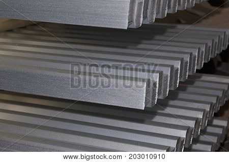 Profiled galvanized sheet in packs at the metal products warehouse Russia