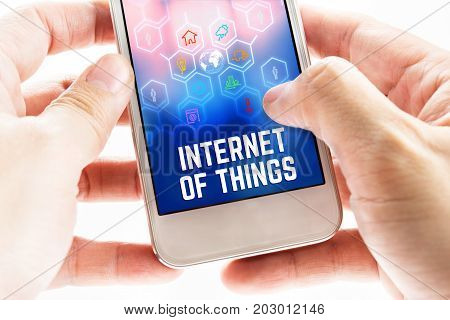Close Up Two Hand Holding Mobile Phone With Internet Of Things (iot) Word And Icons, Digital Marketi