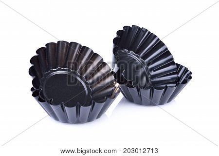 black mini tart tins on white background