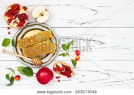 Apple pomegranate and honey traditional food of jewish New Year - Rosh Hashana. Copy space background