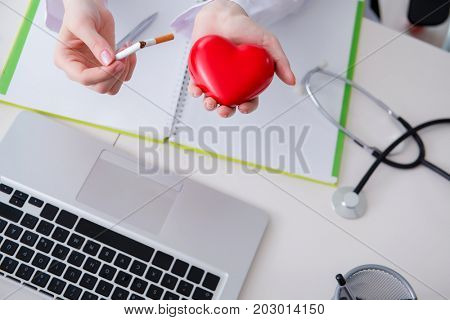 Antismoking concept wih heart in medical concept
