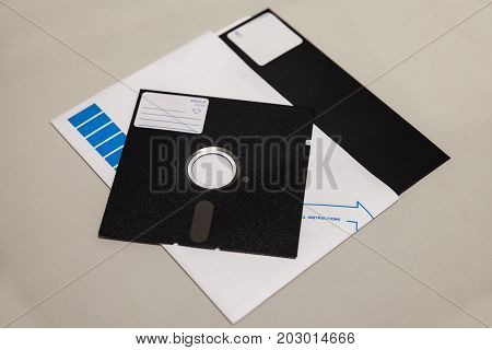 Old 5.25 and 8 inch floppy disks with label isolated on light background