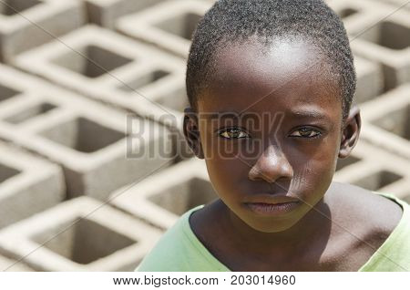 African black boy working outdoors - Child Labour - with blurred background