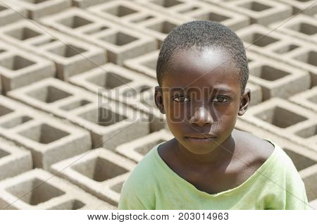Child Exploitation symbol - African black boy with lots of bricks behind him - African Children Labour Labor