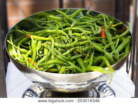 Long Spicy Green Pepper In A Silver Bowl