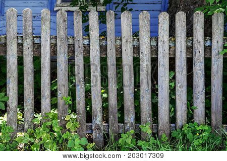 Old weathered rustic wooden fence background, texture
