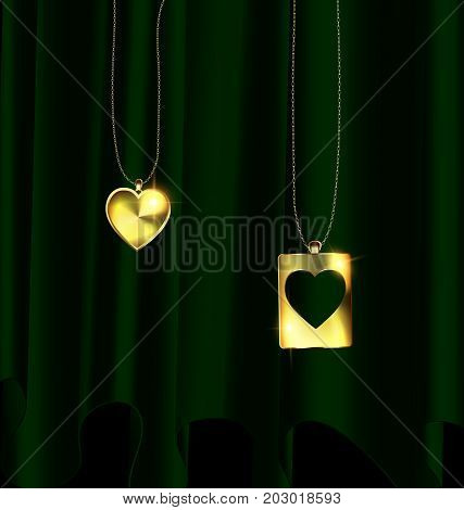 black background dark drape and golden chain with couple of jewelry hearts