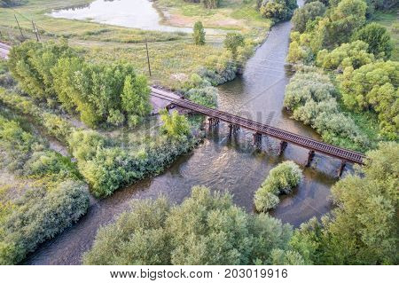aerial view of railroad trestle over a river (Cache la Poudre River in Fort Collins, Colorado)