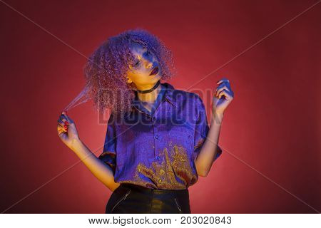 woman with groovy hair and nineteen style of electronic music