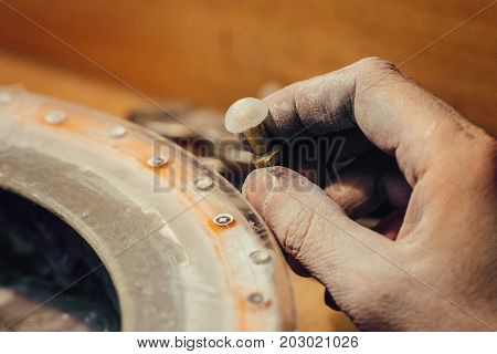 Polishing moonstone at the factory for the extraction and processing of precious stones. Soft selective focus.