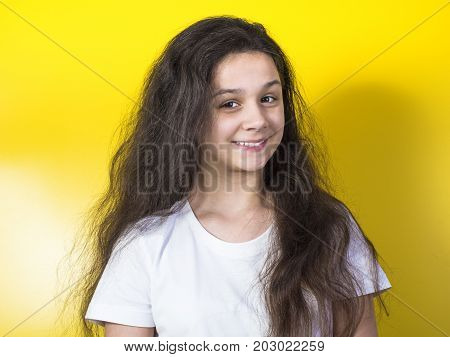 Young 10 Year Old Girl On A Yellow Background
