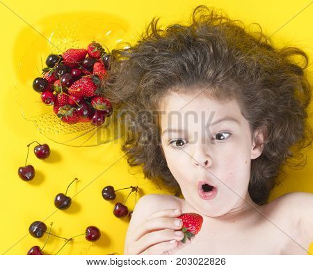 Boy Excited To Eat Strawberries. Dark Hair, Pigtails. Strawberries, Cherries Ripe, Red.