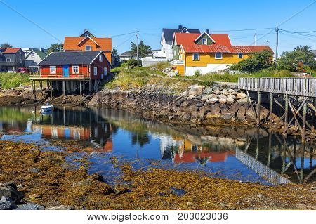 Scenic View Of Colorful Wooden Buildings In Henningsvaer In Summer.