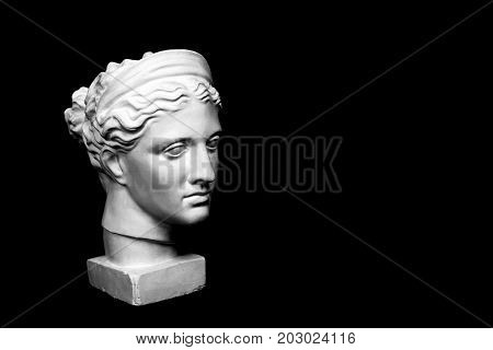 Marble head of young woman, ancient Greek goddess bust isolated on pink background with space for text