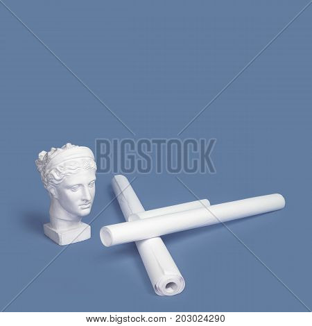 Marble head of young woman, ancient Greek goddess bust with paper rolls or scrolls on pink background. Architecture project, art, building, construction, real estate concept. Space for text.