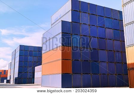container box loading at yardContainer handling. Container truck picking up container at yard. Port logistics container yard operation.