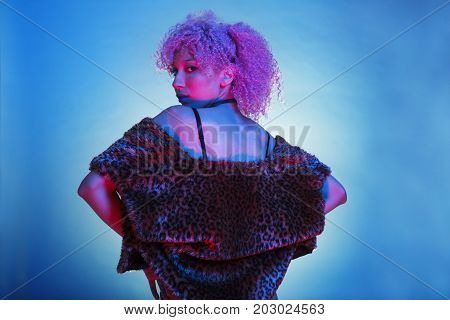 portrait groovy black woman with nightlife style and neon retro lights