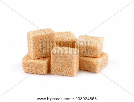 Brown cane sugar cubes Brown cane sugar cubes isolated