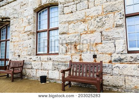 Two Empty Benches on Old Stone Wall in Bermuda